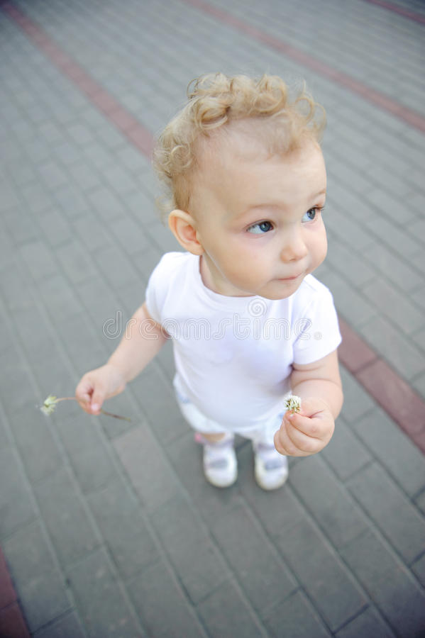 Cute child over pavement background stock images
