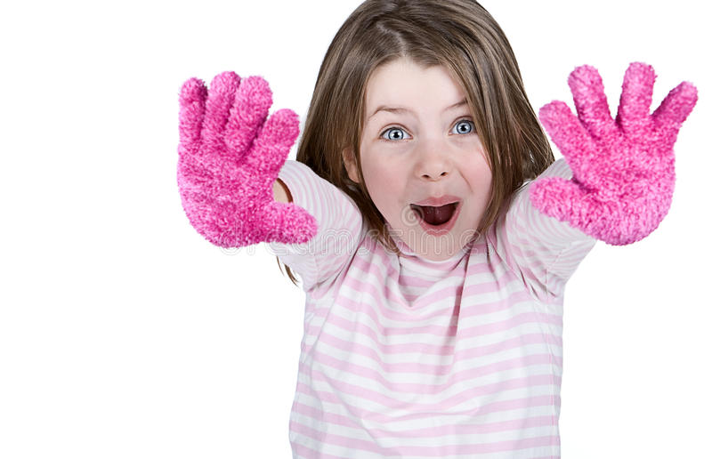 Cute Child with Pink Gloves. Isolated Shot of a Cute Child with Pink Gloves royalty free stock photos