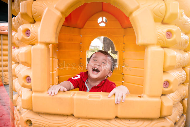 Cute child playing in toy house royalty free stock photo