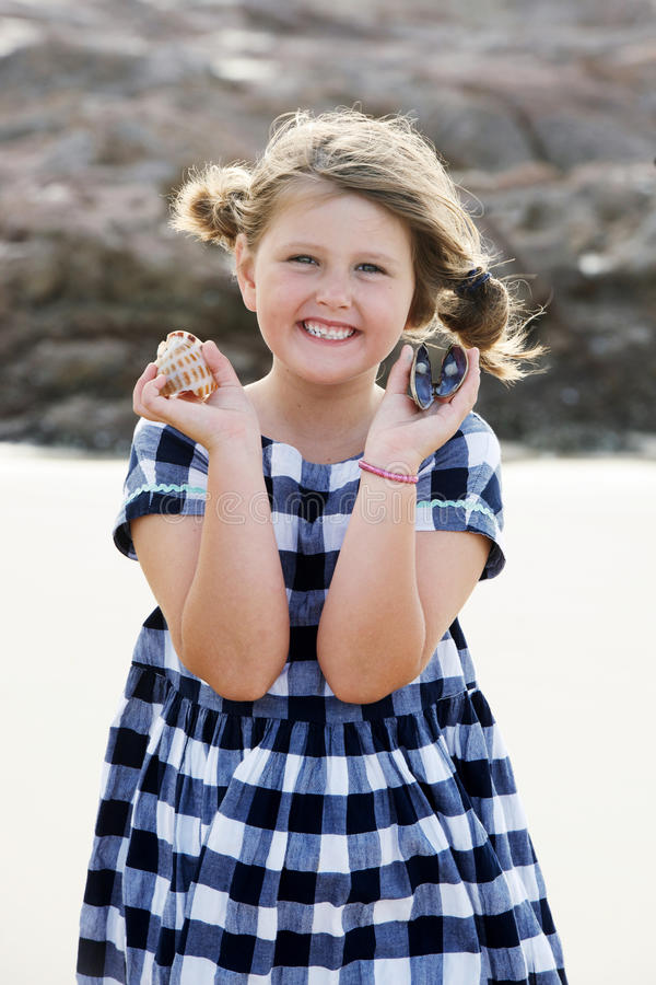 Cute child with shells royalty free stock photo
