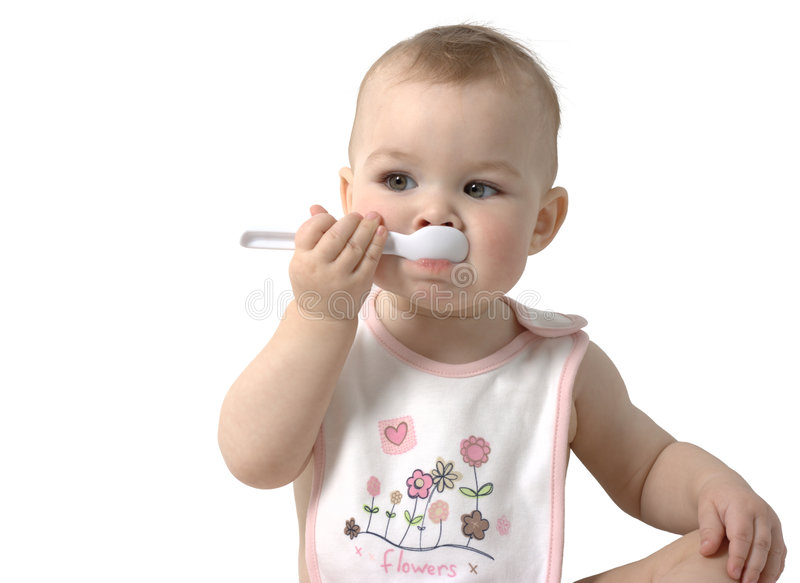 Cute child sucks spoon. Isolated over white stock photos