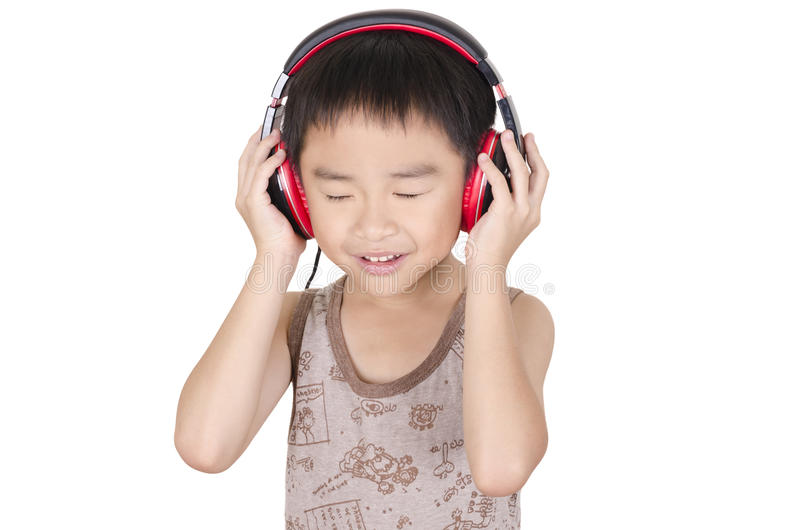 Cute child to be infatuated with music. Cute child listen to music royalty free stock photos