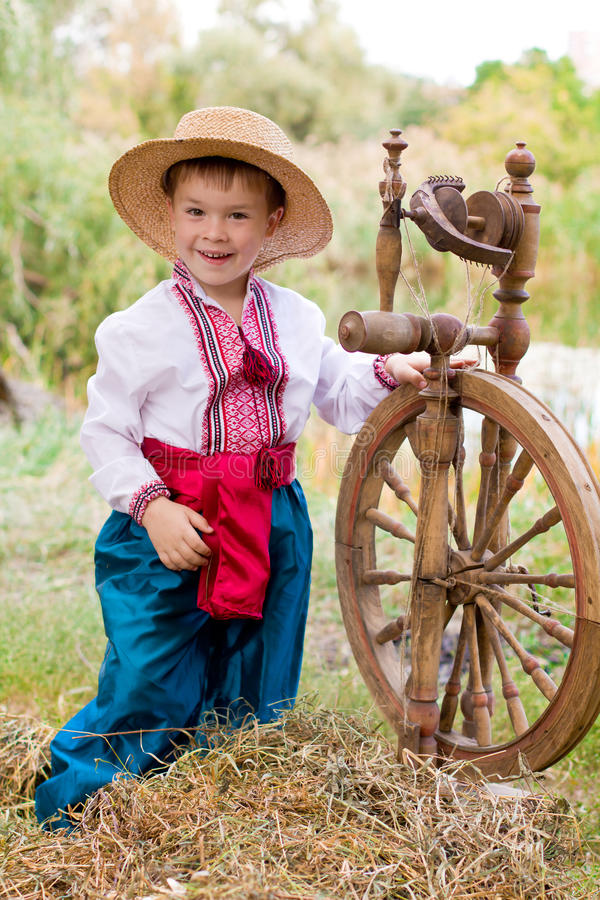 Cute child in traditional eastern european clothes stock photo
