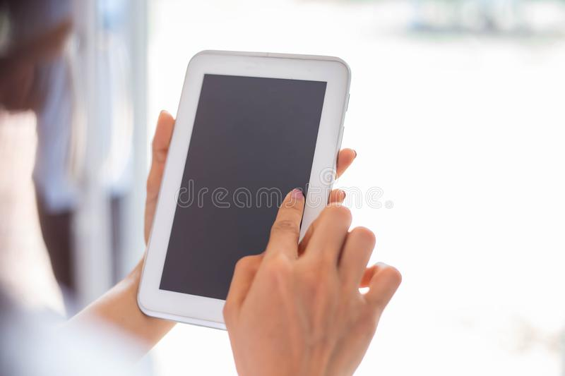 Cute child is using digital tablet royalty free stock image