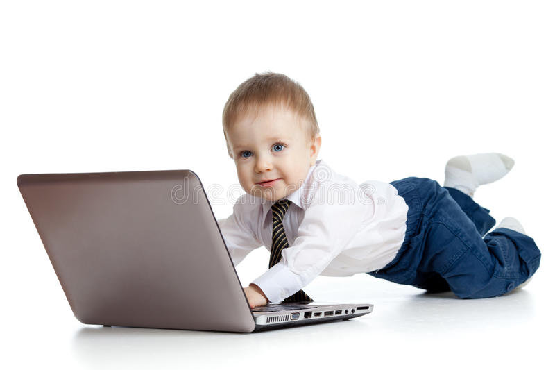 Download Cute child using a laptop stock image. Image of side - 23121927