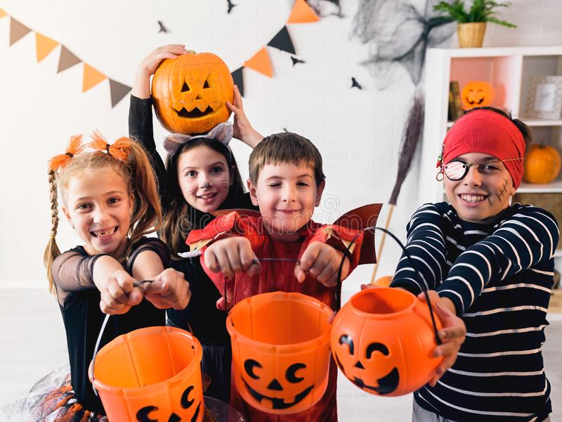 Cute children in costumes trick-or-treating Halloween holiday concept stock image