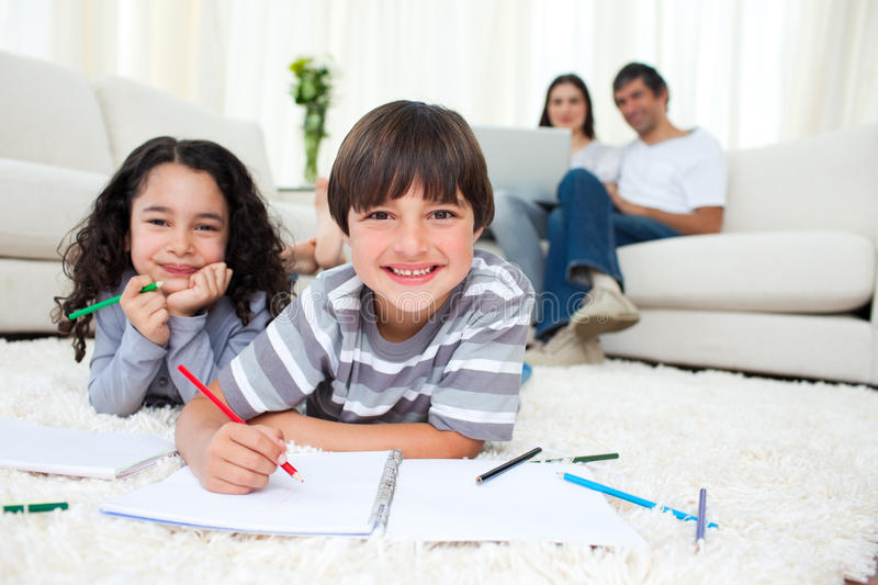 Cute children drawing lying on the floor royalty free stock images