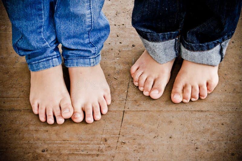 Cute children feet stock photography