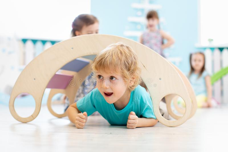 Cute children playing in kindergarten royalty free stock photography
