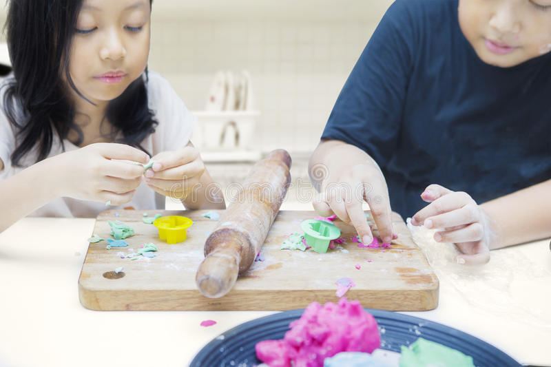 Cute children playing with playdough stock image