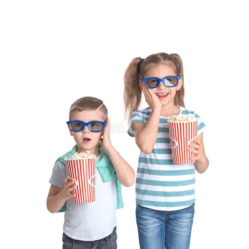 Cute children with popcorn and glasses on white royalty free stock photos
