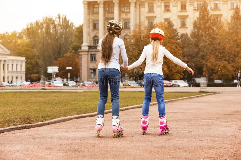 Cute children roller skating royalty free stock photos