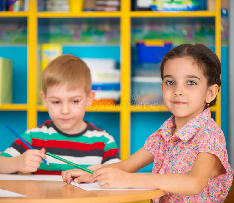 Cute children study at daycare stock photos