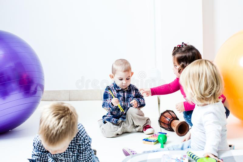 The children play musical instruments royalty free stock photography