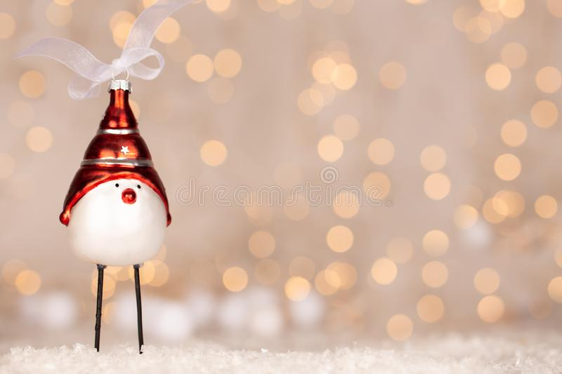 Cute Christmas bird adornment with bokeh of yellow and white christmas lights royalty free stock images