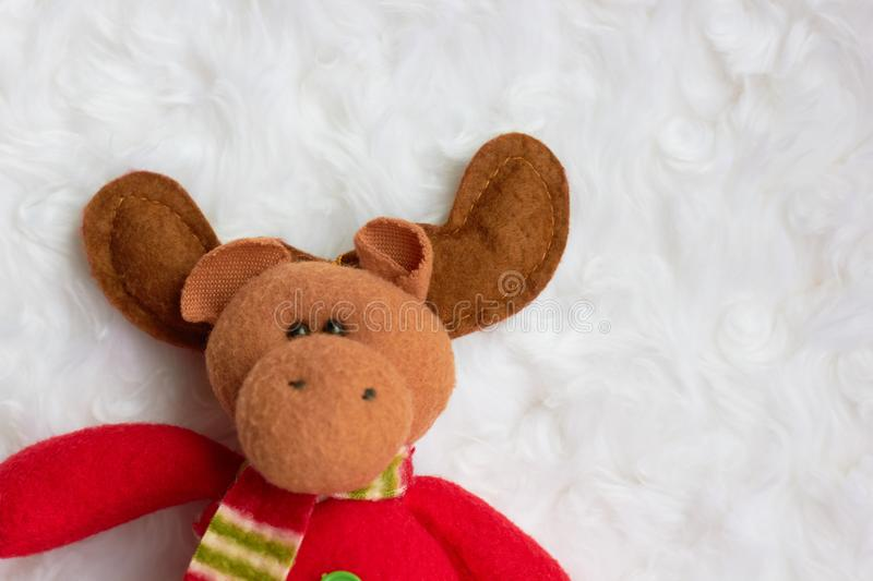 Cute christmas toy elk on white background stock image