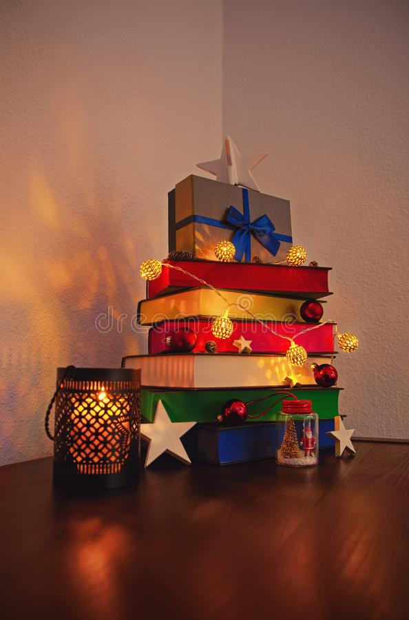 Cute Christmas tree made of colourful books royalty free stock images