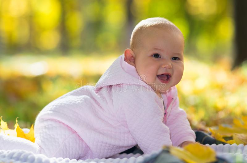 Cute chubby little baby girl laughing at camera. stock photo