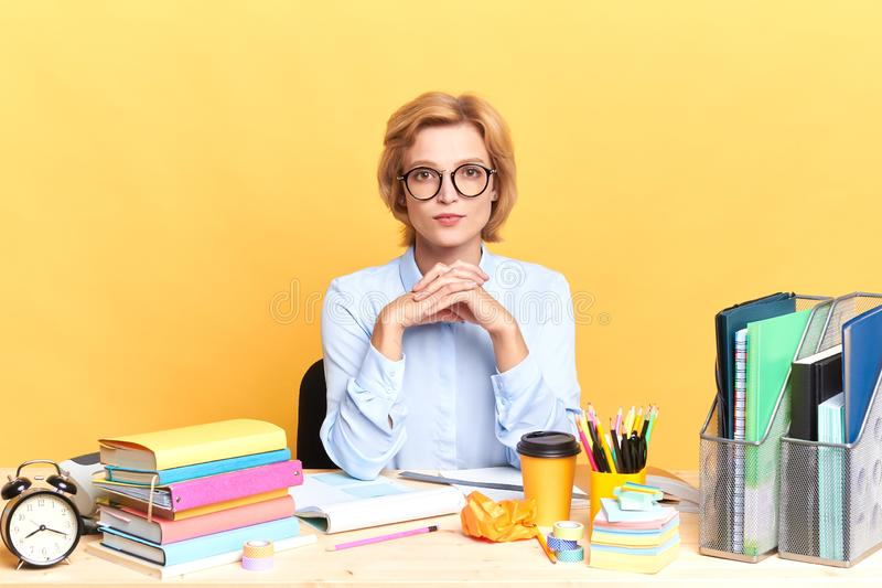 Cute clever businesswoman waiting for a client stock photo