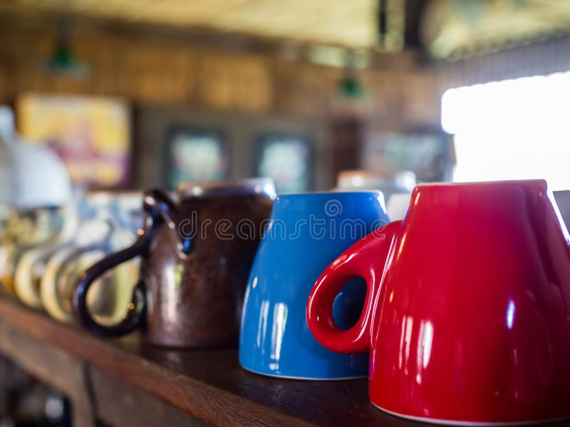 Cute coffee, tea cup on wood shelf stock images