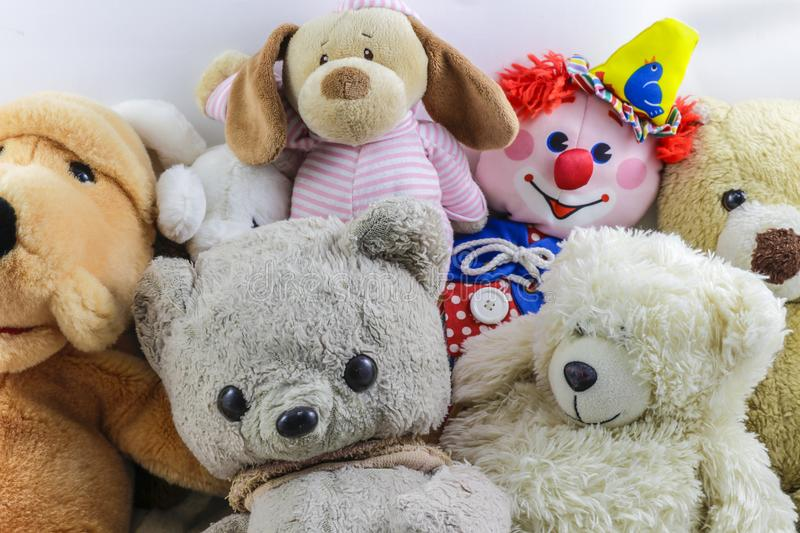 Cute collection of children`s stuffed animals and toys. Several colorful stuffed animals and toys in a pile stock photography