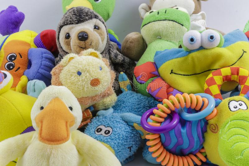 Cute collection of children`s stuffed animals and toys. Several colorful stuffed animals and toys in a pile royalty free stock photography