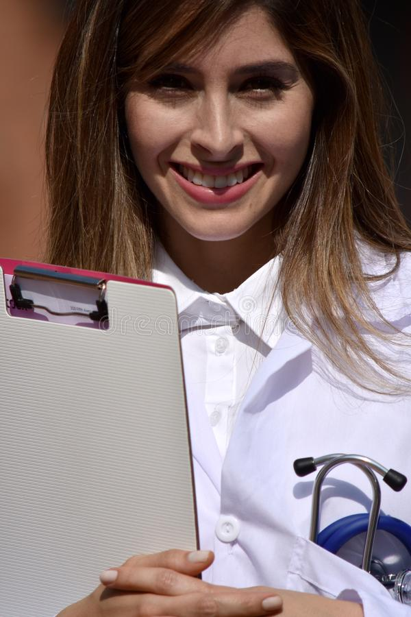 Cute Colombian Female Medic And Happiness With Clipboard. A pretty young Colombian adult female royalty free stock images