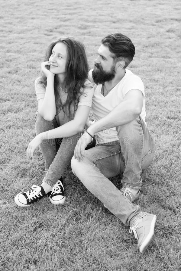 Cute couple. fashion couple having fun together. cute girl and bearded man hipster on green grass. couple in love stock photo