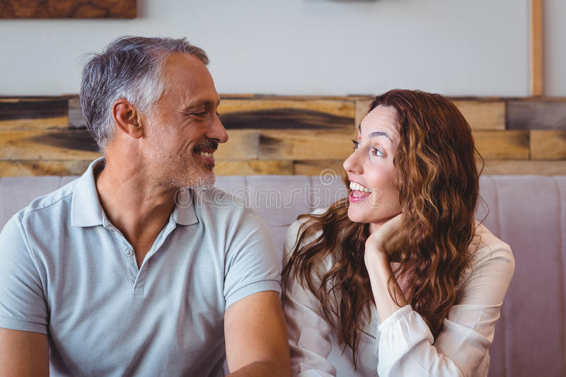 Cute couple laughing. In the cafe stock image