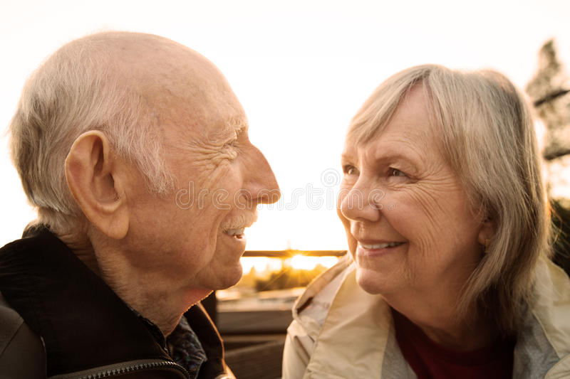 Cute Couple Looking at Each Other. Senior couple smiling and looking each other stock photos