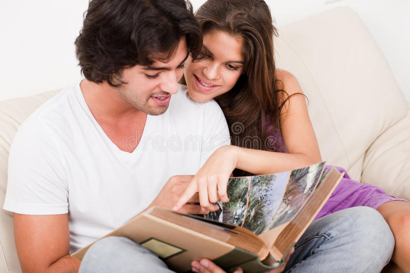 Cute couple looking photos royalty free stock images