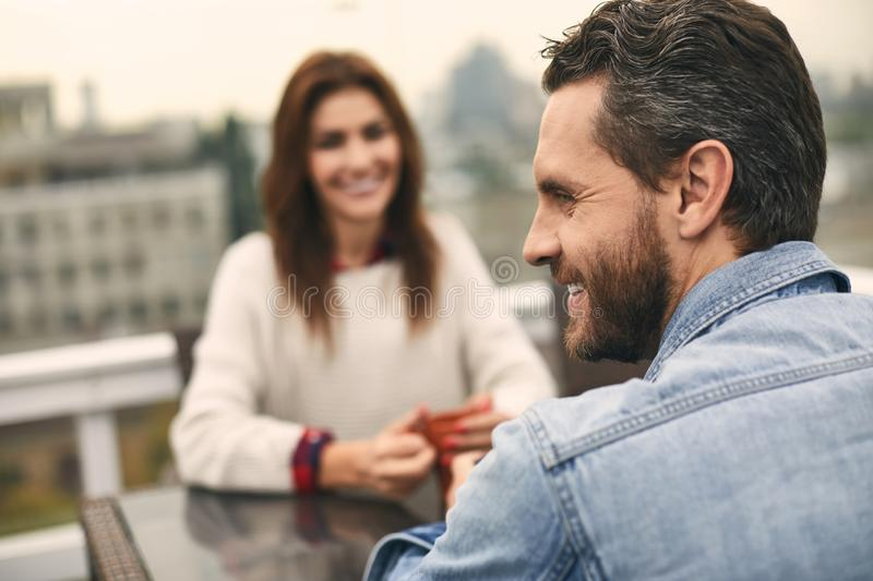 Cute couple is sitting in cafe together stock photos