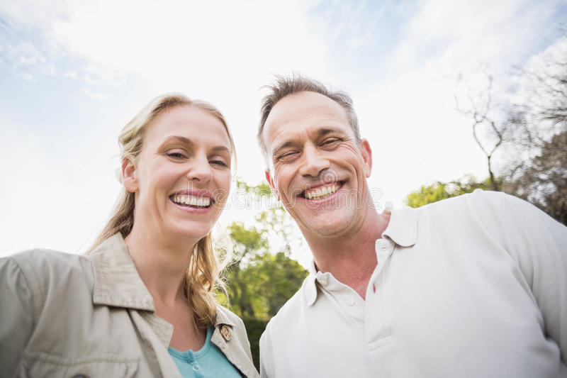 Cute couple smiling at each other. Outside stock images
