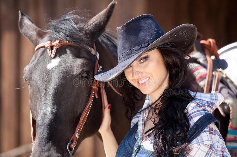 Download Cute cowgirl on ranch stock photo. Image of white, farm - 15562114