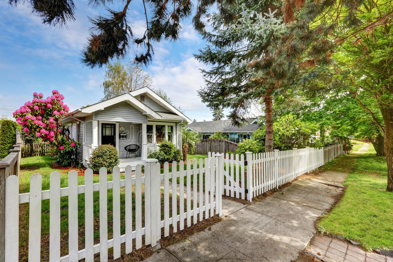 Cute craftsman home exterior with picket fence. Northwest, USA royalty free stock photo