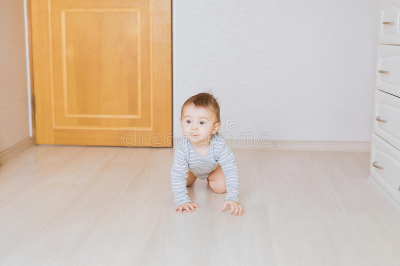 Cute crawling funny baby boy indoors at home royalty free stock images