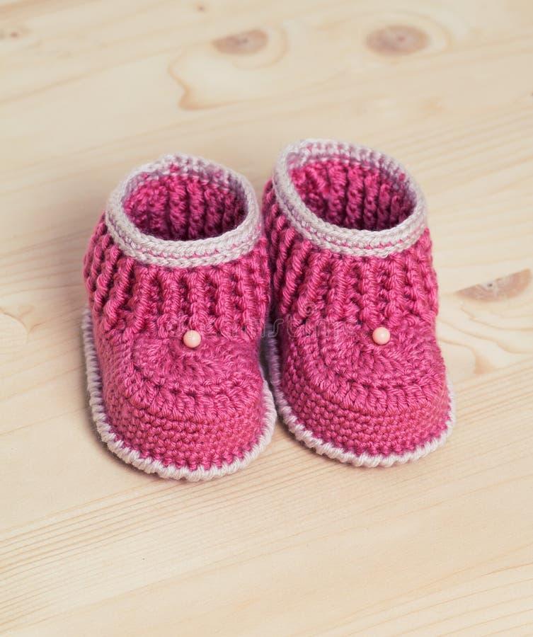 Cute Crochet Baby Booties On Wooden