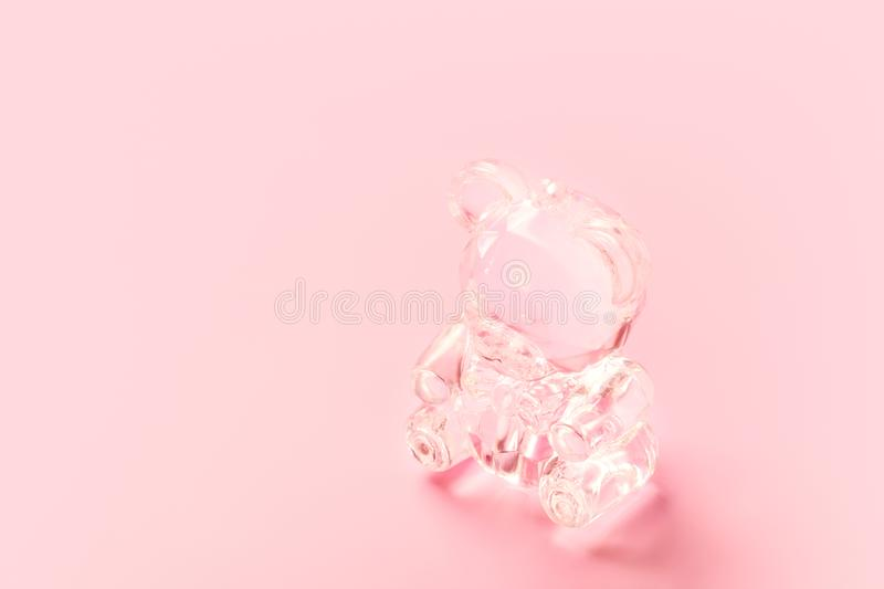 Cute crystal teddy bear toy on pink background. Cute crystal teddy bear toy on tender pinky background stock photo