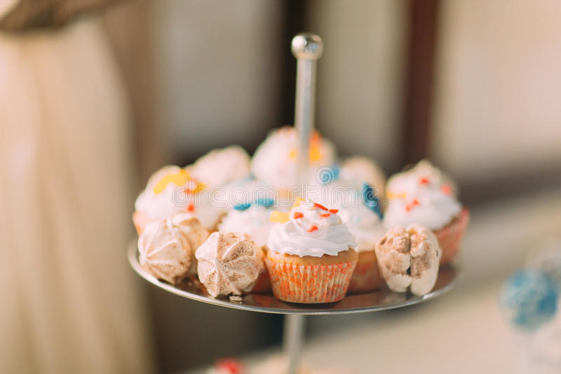 Cute cupcakes on tier at wedding reception.  royalty free stock photo