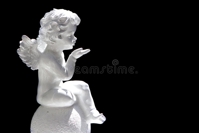 Cute cupid angel over black background stock photos