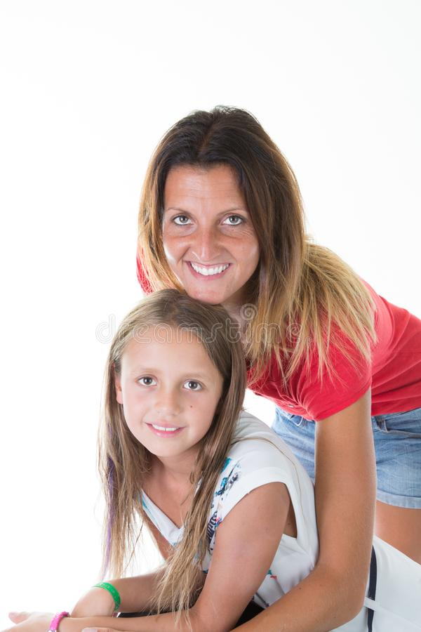 cute daughter girl with beauty woman mother in white stock photo