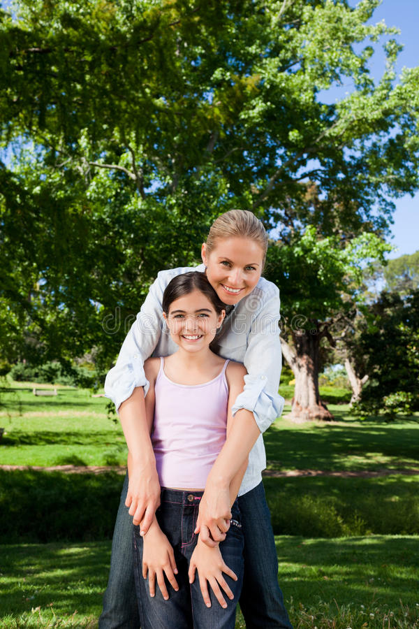Cute Daughter With Her Mother In The Park Royalty Free Stock Photo