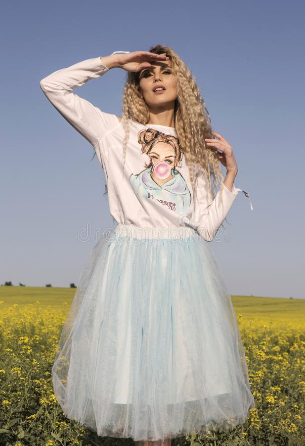 Cute doll look. White and blue romantic dress over blue sky. stock image