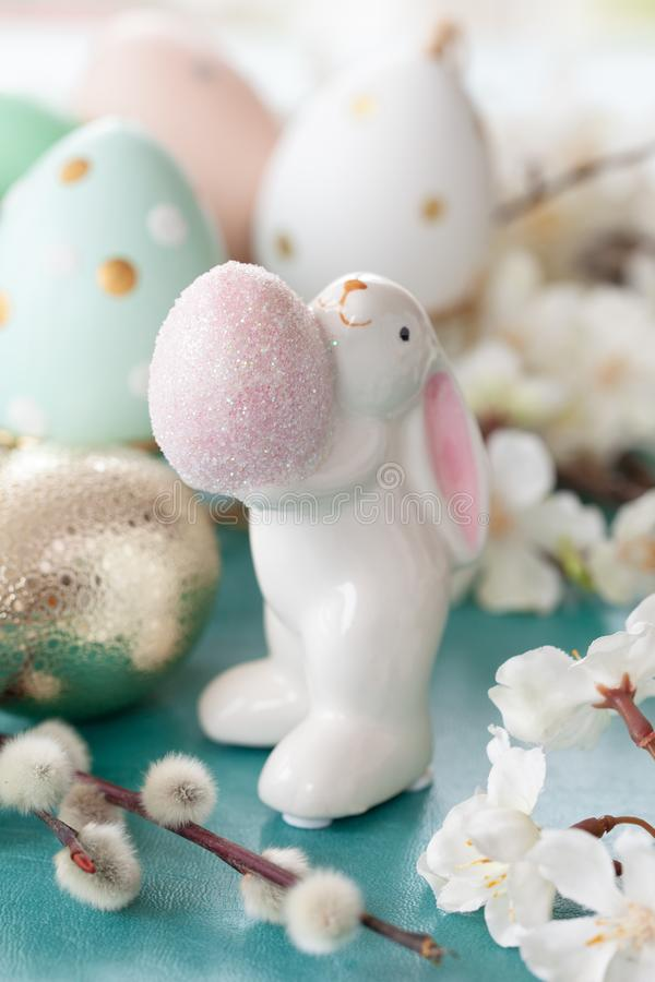 Cute easter bunny. Cute bunny holding an easter eggs and spring blossoms royalty free stock photography