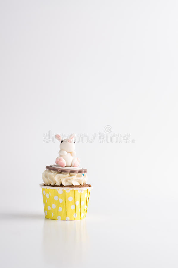 Cute easter chocolate cupcakes with bunny on the top. One cute easter chocolate cupcakes with bunny on the top on white background stock photos