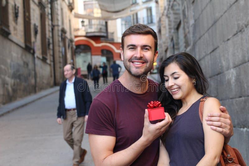 Cute ecstatic man proposing outdoors. Cute ecstatic men proposing outdoors royalty free stock images