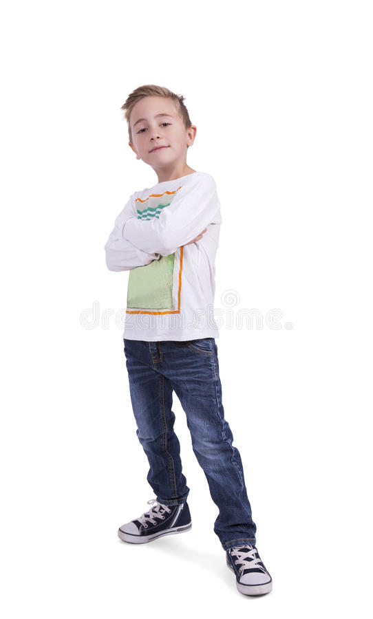 Cute elementary boy with arms crossed stock photos