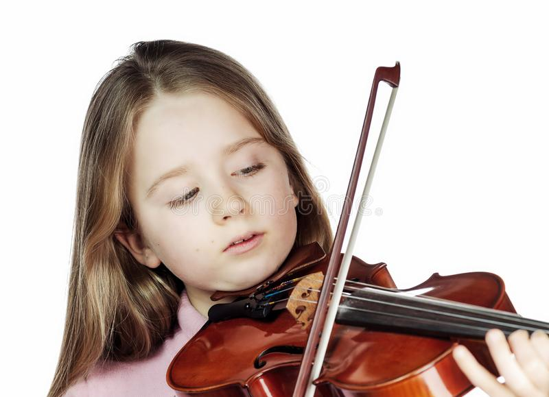 Cute little girl with violin, music and educational concept, isolated on white. Cute emotive little girl with violin, music and educational concept, isolated on royalty free stock images