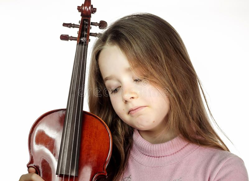 Cute little girl with violin, music and educational concept, isolated on white. Cute emotive little girl with violin, music and educational concept, isolated on royalty free stock photo