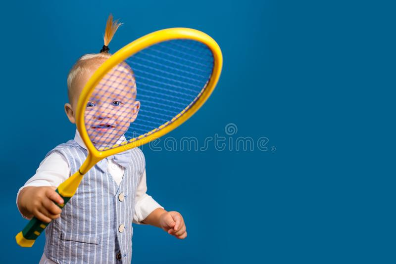 Cute and energetic. Little sport lover. Adorable little child with tennis racket. Active happy child. Small tennis royalty free stock photos